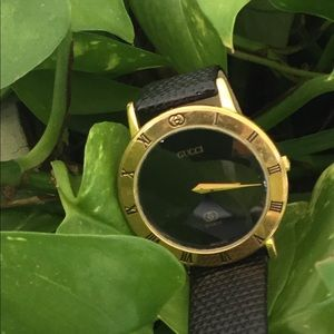 Gucci Vintage Gold Black Face Watch
